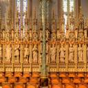 Sanctuary, left side: the first ten statues and the choir stalls. Note the neo-Gothic spires above each of the large statues.
